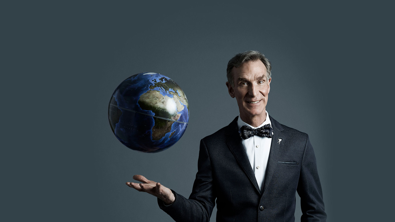 Bill Nye with a globe